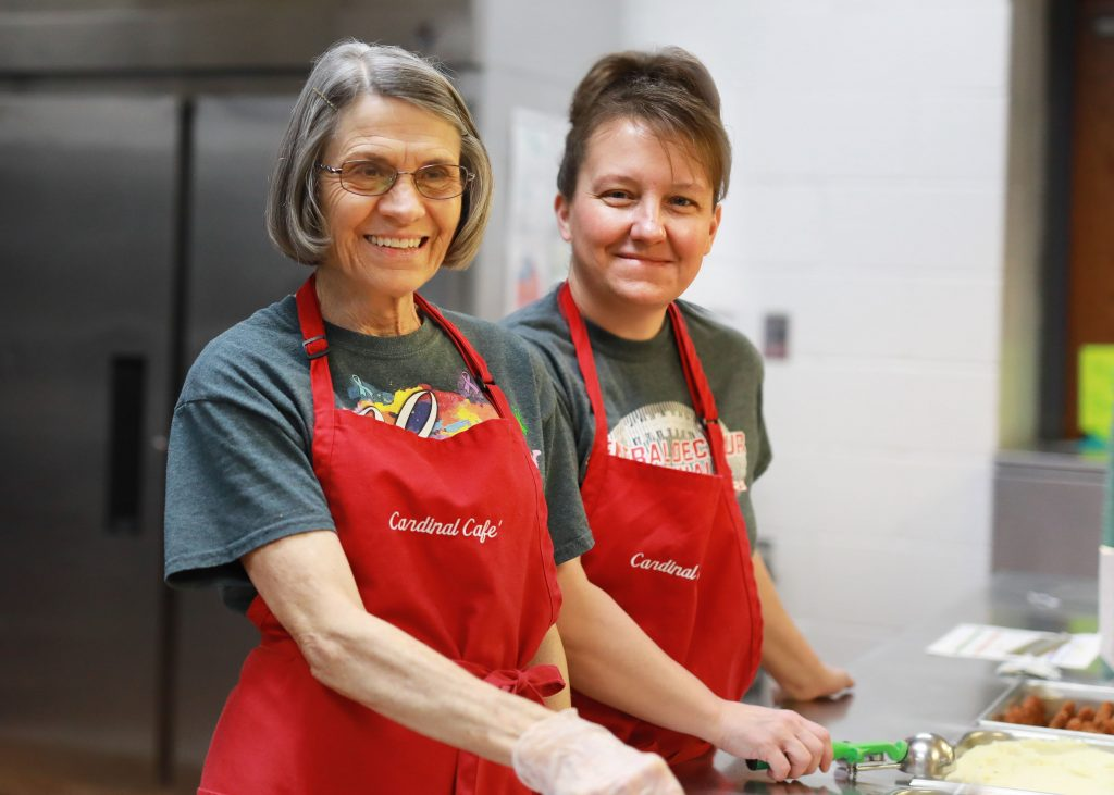 Nutrition workers prepare to serve lunch.