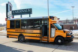 CD bus near a Cardinals sign