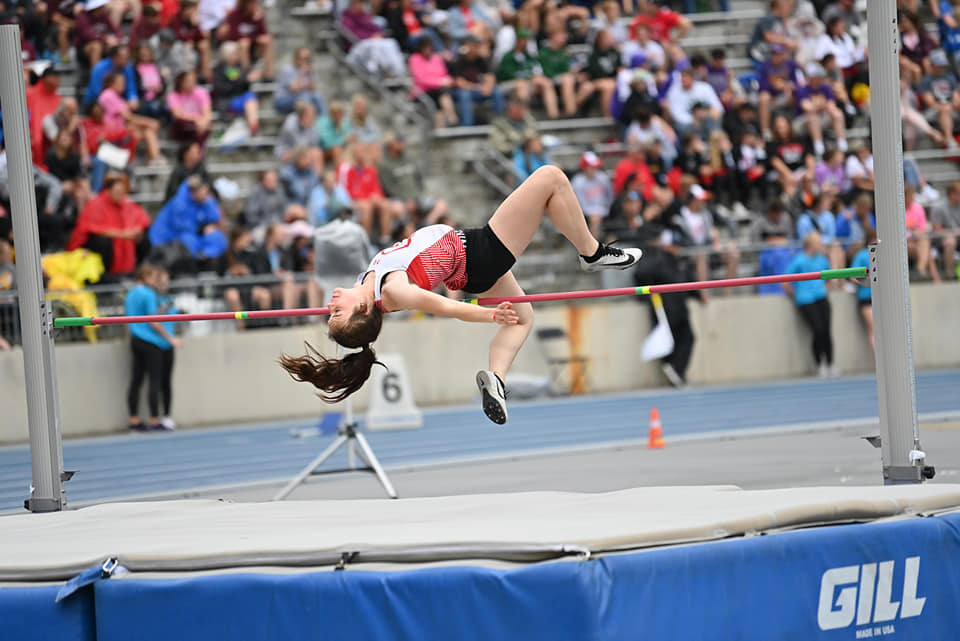 RIver Hamaker high jumping at the state tournament.